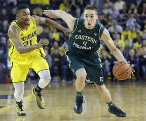 Brandon Nazione of the Eastern Michigan Eagles drives to the basket against Zak Irvin of the Michigan Wolverines during the second half at Crisler Arena on December 9, 2014. (Duane Burleson/Getty Images/AFP)