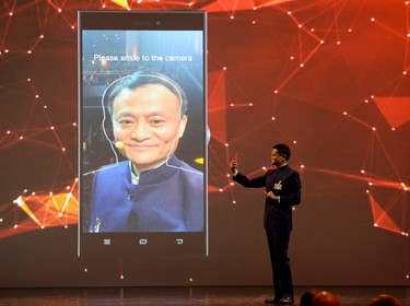 Alibaba founder and chairman Jack Ma makes a presentation during the official opening of the CeBIT trade fair in Hanover March 15, 2015. REUTERS/Fabian Bimmer