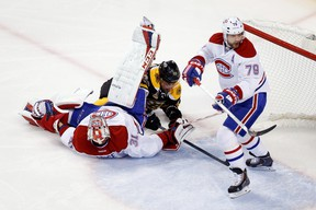 Boston Bruins forward Brad Marchand slides under Montreal Canadiens goalie Carey Price and is called for interference during the first period in Game 7 of the second round of the 2014 NHL playoffs at TD Banknorth Garden on May 14, 2014. (Greg M. Cooper/USA TODAY Sports)