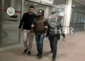 A screen grab from video released by Turkish A Haber news channel shows what is believed to be the Syrian man detained by Turkish authorities on suspicion of helping British girls join ISIS. The man has told his interrogators he was spying for Canada in exchange for eventual Canadian citizenship. (Handout/HBR)