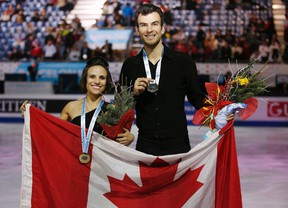 Canadians Meagan Duhamel and Eric Radford pose with their gold medals after winning the final of the ice pairs skating competition at the Grand Prix of Figure Skating in December. (Reuters)
