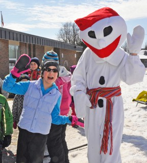Dayna Vosper (left) poses for a photo with Bonhomme during the annual Winter Carnaval at St. Columban School last Thursday, March 12. KRISTINE JEAN/MITCHELL ADVOCATE