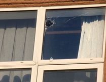 Damage to a top floor window at the scene of a sudden death at the Super 8 motel at 32 ave and Barlow Trail in Calgary, Alta., on Monday March 16, 2015. Mike Drew/Calgary Sun/QMI Agency