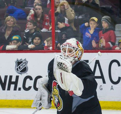 Ottawa Senators goaltender Andrew Hammond under the watchful eyes of fans who were allowed to attend the game day skate at the CTC on Thursday March 19, 2015. Errol McGihon/Ottawa Sun/QMI Agency