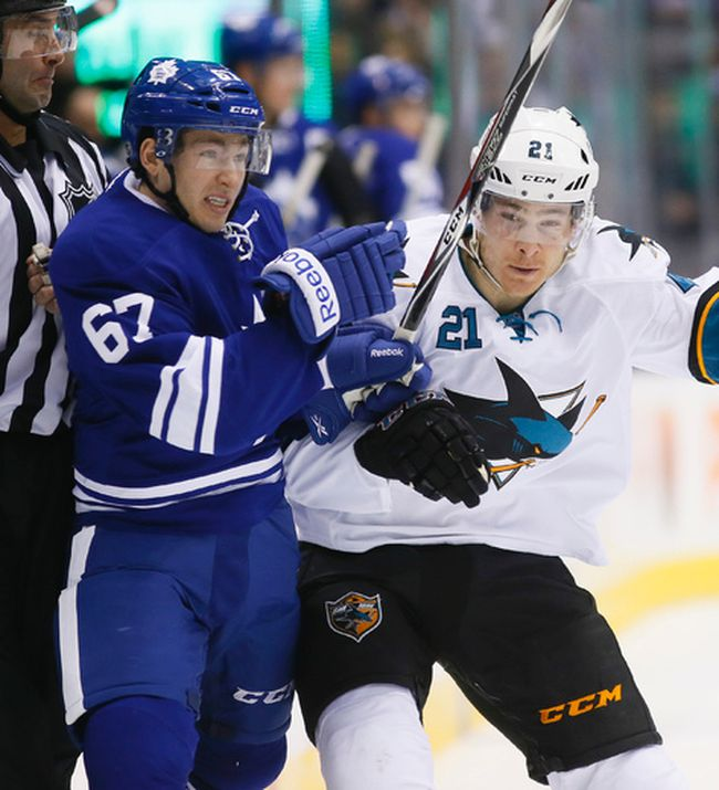 Brandon Kozun and Ben Smith tangle in the first period as the Toronto Maple Leafs play the San Jose Sharks at the Air Canada Centre in Toronto on Thursday March 19, 2015. Stan Behal/Toronto Sun/QMI Agency