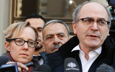 Defence attorney John Norris, right, his co-counsel Breese Davies, left, and Mohammed Jaser, middle -- father of Raed Jaser outside the University Ave. courthouse on March 20, 2105. (Jack Boland/Toronto Sun)