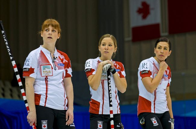 Canada's Dawn McEwen (from left), Kaitlyn Lawes and Jill Officer watch Switzerland play during the Page Playoff 1-2 game at the World Women's Curling Championships in Sapporo, Japan, March 21, 2015. (REUTERS/Thomas Peter)