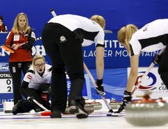 Switzerland's skip Alina Paetz (3rd R) calls out to her sweepers Marisa Winkelhausen (2nd R) and Nicole Schaegli (R) as Canada's skip Jennifer Jones (2nd L) watches during their final curling match at the World Women's Curling Championships in Sapporo March 22, 2015. Pictured at L is Team Canada coach Wendy Morgan. REUTERS/Thomas Peter