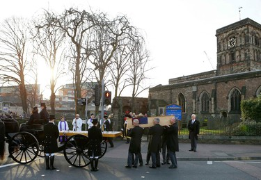 Richard III's coffin is placed on a horse drawn carriage outside St. Nicholas' church during his reburial procession in Leicester, central England, March 22, 2015. Richard III's remains are being carried in procession through Leicestershire today on its way to the cathedral where they will be reburied. The body of Richard III, who died at the battle of Bosworth in 1485, was found under a car park in 2012.    REUTERS/Darren Staples
