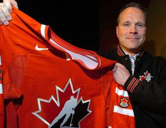 Dave Lowry holds up a Team Canada hockey sweater. (QMI Agency)