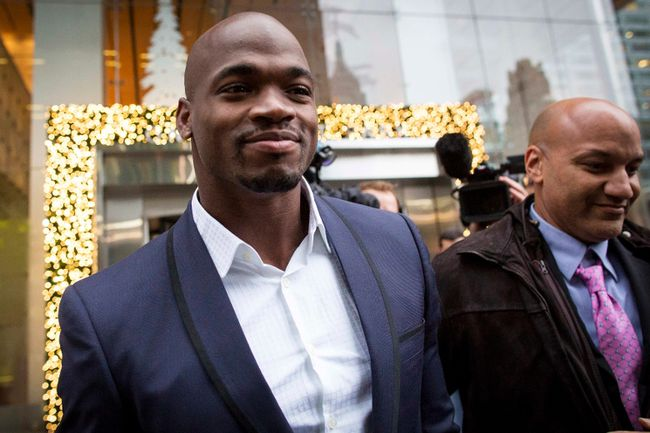 Suspended Minnesota Vikings running back Adrian Peterson (left) exits following his hearing against the NFL over his punishment for child abuse in  New York in this December 2, 2014 file photo. (REUTERS/Brendan McDermid/Files)