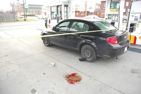 Sudbury Star file photo The car used in an armed robbery of the Food Basics store on Notre Dame Avenue on Nov. 3, 2012, is shown cordoned off with police tape in this file photo.