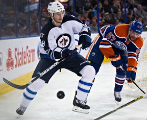 Benoit Pouliot chases Winnipeg's Jacob Trouba during the second period of Monday's game at Rexall Place. (Codie McLachlan, Edmonton Sun)