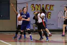Action from the provincial high school girls basketball championship final between Sisler Spartans and Oak Park Raiders, on Monday, March 23, 2015, at the Duckworth Centre. The Spartans won 83-51. RUSTY BARTON, For the Winnipeg Sun