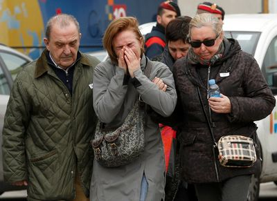 Family members of passengers feared killed in Germanwings plane crash react at Barcelona's El Prat airport on March 24, 2015. (REUTERS/Gustau Nacarino)