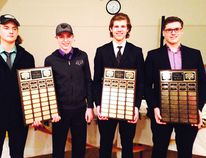 Tyson Dyck, Nic Dairyample, Zac Neufeld and Keegan Lacroix pose with their awards from the 2014-15 PCI Trojans boys varsity hockey banquet. (submitted photo)