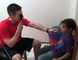 Local optometrist Tom Wilk provides an eye exam for a young boy in Costa Rica, who walked five hours to be able to see a doctor with the other 18 students in his class.