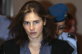 Amanda Knox, the U.S. student convicted of murdering her British flatmate Meredith Kercher in Italy in November 2007, arrives at the court during her appeal trial session in Perugia in this September 30, 2011 file photo. Italy's highest court was expected to rule on March 25, 2015 on whether to uphold the conviction of Knox and her former Italian boyfriend for the 2007 killing of British student Meredith Kercher. REUTERS/Alessandro Bianchi/Files