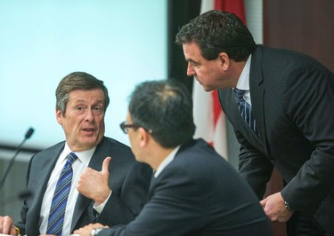 Toronto mayor John Tory (left), Coun. Giorgio Mammoliti (right) and Coun. Denzil Minnan-Wong (middle) before the afternoon start of a  meeting of the executive committee at city hall in Toronto, Ont. on Wednesday March 25, 2015. Ernest Doroszuk/Toronto Sun/QMI Agency