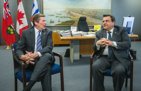 Toronto Mayor John Tory (left) sits in his office with visiting Montreal Mayor Denis Coderre at City Hall in Toronto Wednesday March 25, 2015. (Ernest Doroszuk/Toronto Sun)