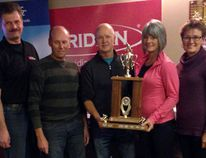 Left, Randall Siemens of Rocky Mountain Equipment presents the trophy to the winning team including Jamie Hartry, Rob Reimer, Linda Reimer and Denise Hartry. (SUPPLIED PHOTO)