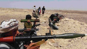 Southern Movement militants take up positions in the Jabal al-Ierr area of Yemen's southern Lahej province, as they prepare to secure the area against Shi'ite Houthi fighters, March 7, 2015. Most of Yemen has been left without state services or authority, and deadly violence is a daily occurrence as Houthis, state security forces, tribesmen, southern separatists and al Qaeda militants clash with each other.  REUTERS/Stringer