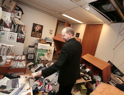 Bill Tieleman surveys damage to his office in December 2007 after it was broken into following columns about the BC Rail scandal. (FILE PHOTO)
