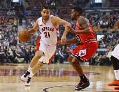 Toronto Raptors guard Greivis Vasquez (21) drives to the net against Chicago Bulls guard Aaron Brooks (0) on March 25. (USA Today Sports)