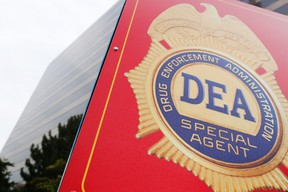 A sign with a DEA badge marks the entrance to the U.S. Drug Enforcement Administration (DEA) Museum in Arlington, Virginia, August 8, 2013. A secretive U.S. Drug Enforcement Administration unit is funneling information from intelligence intercepts, wiretaps, informants and a massive database of telephone records to authorities across the nation to help them launch criminal investigations of Americans.  REUTERS/Jonathan Ernst