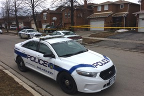 Peel Regional Police at at the scene of a double stabbing on McGraw Ave. in Brampton Thursday, March 26, 2015. (CHRIS DOUCETTE/TORONTO SUN)