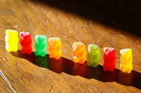 Marijuana-infused sour gummy bear candies are shown next to regular ones at left.  (REUTERS/Rick Wilking)