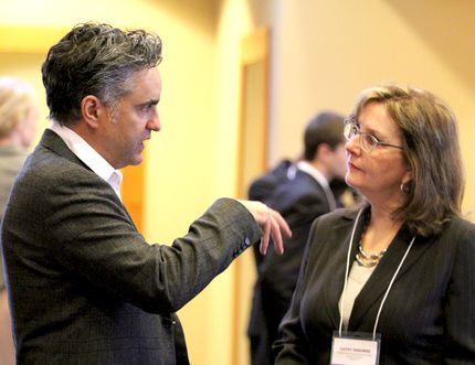 Bruce Croxon, formerly of Dragon's Den, talks with Cathy Denomme, assistant professor and head of business and economics at Algoma University, at Algoma's Water Tower Inn.