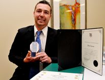 Michael O'Brien, grandson of Don and Shirley Green, poses with Don Green's Lifetime Business Achievement Award and certificates from MP Gord Brown and MPP Steve Clark after a Brockville and District Chamber of Commerce presentation at the Brockville Convention Centre on Thursday. (RONALD ZAJAC/Brockville Recorder and Times/QMI Agency)