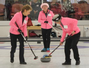 Liz Baer, left, Teresa Wilson and Alice Pignal from the Royal Kingston Curling Club dressed to impress in pink for the 43rd annual Grandmothers and Great-Aunts bonspiel at the Royal Kingston Curling Club on Wednesday. (Julia McKay/The Whig-Standard)