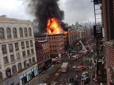 Fire shoots from the roof of a building after it collapsed and burst into flames in New York City's East Village as seen in this picture taken by Scott Westerfeld March 26, 2015.  Rescuers from the Fire Department of New York (FDNY) were headed to the location, which was on Second Avenue and East 7th Street in Manhattan, an FDNY spokeswoman said.   REUTERS/Scott Westerfeld