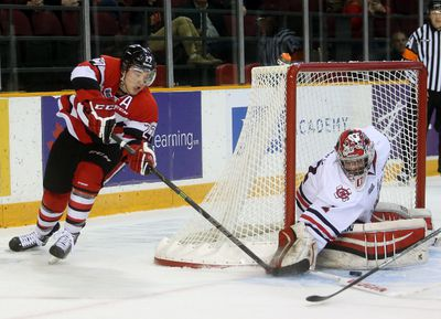OTTAWA, ONT (26/03/15)Ottawa 67s'  Brendan Belltries to wrap the puck around the Niagara Ice Dogs' Brandon Hope during the first period of game one of the teams' first round playoff battle, Thursday, Mar. 26, 2015 at TD Place. Andrew Meade/ Ottawa Sun