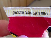 A Newfoundland woman says she was disqualified from claiming a $100 Tim Hortons' gift card she had won on her Roll-Up-the-Rim-to-Win tab because of a little-known rule that winners are required to provide the whole upper edge of the cup. (QMI Agency/Samantha Burke)