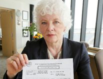 Dr. Hazel Lynn holds a notice sent to nearly 1,800 students whose parents must provide proof their shots are up to date or seek an immunization exemption by April 20 or students will be suspended from school until the information is provided. Most are vaccinated but some may not be, she said. (James Masters/QMI/Owen Sound)