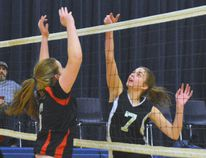 Breanna McCann-Williams (right) of the Simcoe Xtreme is airborne for an attack against the LVC Fire 17U Intensity. (EDDIE CHAU Simcoe Reformer)