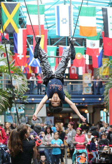 Kenneth Marquez, 12, takes a turn on the trapeze during a workshop at the 15th annual Festival of Fools put on by the Winnipeg International Children's Festival at the Forks on Sat., March 28, 2015. Kevin King/Winnipeg Sun/QMI Agency