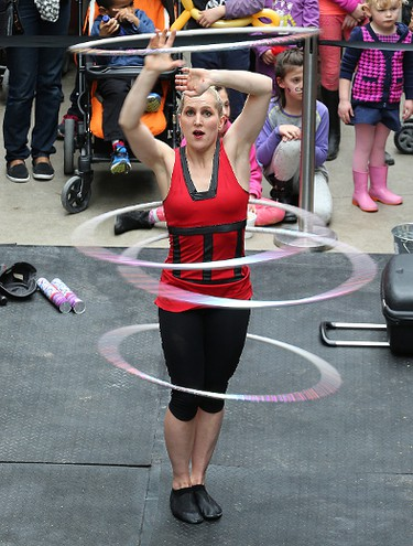 Kimberly Craig of The Street Circus performs with four hula hoops during the 15th annual Festival of Fools put on by the Winnipeg International Children's Festival at the Forks on Sat., March 28, 2015. Kevin King/Winnipeg Sun/QMI Agency