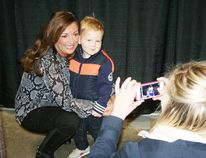 Tracy McNamara of Woodstock snaps a photo of her son, Bentley, 2, with Sandra Rinomato who was one of the celebrity guest speakers at the 2015 Woodstock Home Show on the weekend. A real estate expert, Rinomato was the host of the HGTV show Property Virgins from 2006 to 2012. She has also appeared on The View, CNN, Steven and Chris, The Nate Berkus Show and Marilyn Dennis. Damon Bennet, who has worked closely with Canadian construction guru Mike Holmes in all three of his television series, was also among the celebrity guest speakers at this year's show. JOHN TAPLEY/SENTINEL-REVIEW/QMI AGENCY