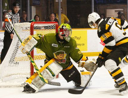 Dave Dale/The Nugget Kingston Frontenacs' Juho Lammikko (82) reaches for the puck as teammate Ryan Verbeek (9) watches and North Bay Battalion goalie Jake Smith (1) moves to get into position during first period OHL Eastern Conference quarterfinal action at Memorial Gardens in North Bay, Sunday. Smith dove across the crease to make the save. Kingston pulled within a goal in the third period but lost the second game of the series 3-2 after being bombed 8-0 Friday. Game three is in Kingston Tuesday evening.