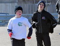 Matthew White tries to hold his lead over Bronson Greaves in the one-kilometre run in the third and final Freeze Your Buns series race, held Sunday at the Memorial Centre. (JONATHON BRODIE/The Recorder and Times)