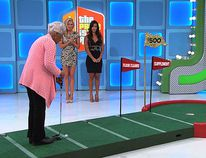 """Margaret showing off her illegal """"clinching"""" putt. (The Price of Right / CBS)"""