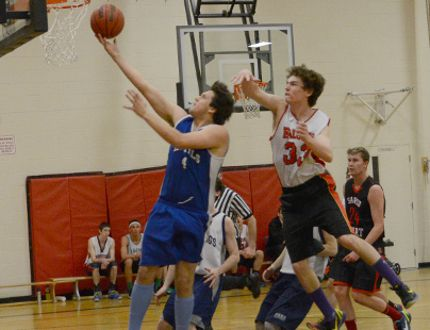 Saugeen District's Shannin Bluebird (left) goes in for a layup as OSCVI's Matt Wardrop (right) tries to block it during the annual Bluewater Athletic Association senior boys basketball game on Monday at OSCVI.