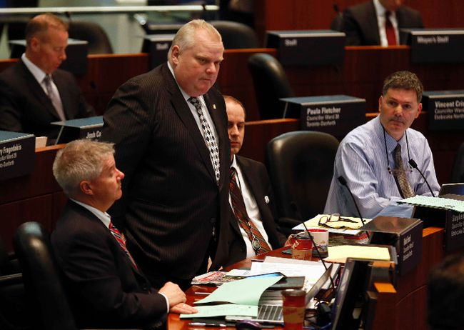 Councillor Rob Ford makes an apology to Samuel Getachew who filed a Formal Complaint with Toronto's Integrity Commissioner at City Hall in Toronto, Ont. on Tuesday March 31, 2015. Stan Behal/Toronto Sun/QMI Agency