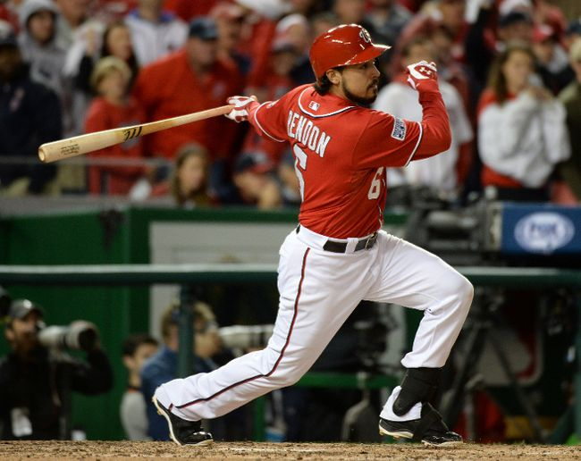 Washington Nationals third baseman Anthony Rendon (6) hits a single in the eighth inning against the San Francisco Giants in game two of the 2014 NLDS playoff baseball game at Nationals Park.  H. Darr Beiser-USA TODAY Sports