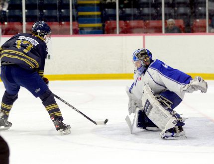 Chad Denault, of the Timmins Eagles, lifts a backhand shot on net that Sudbury Technica Wolves goalie Alex Vendette was able to stop during the first period of a game at the McIntyre Arena on Tuesday afternoon as part of the 2015 All-Ontario Bantam 'AAA' Hockey Championships. The Wolves, champions of the NOBHL, defeated the host Eagles 5-2.