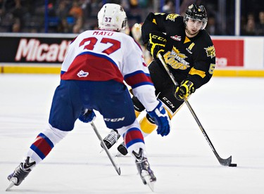 Edmonton's Dysin Mayo defends against Brandon's Colton Waltz during the first period of the Edmonton Oil Kings' WHL hockey game against the Brandon Wheat Kings at Rexall Place in Edmonton, Alta., on Tuesday, March 31, 2015. Codie McLachlan/Edmonton Sun/QMI Agency